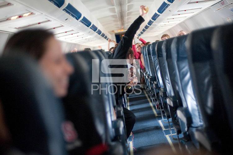 SAN JOSE, CA--Chiney Ogwumike celebrates a successful takeoff ritual of rolling an object down the center aisle during takeoff at Atlantic Aviation in San Jose, en route to Norfolk, VA for the first and second rounds of the 2012 NCAA tournament.