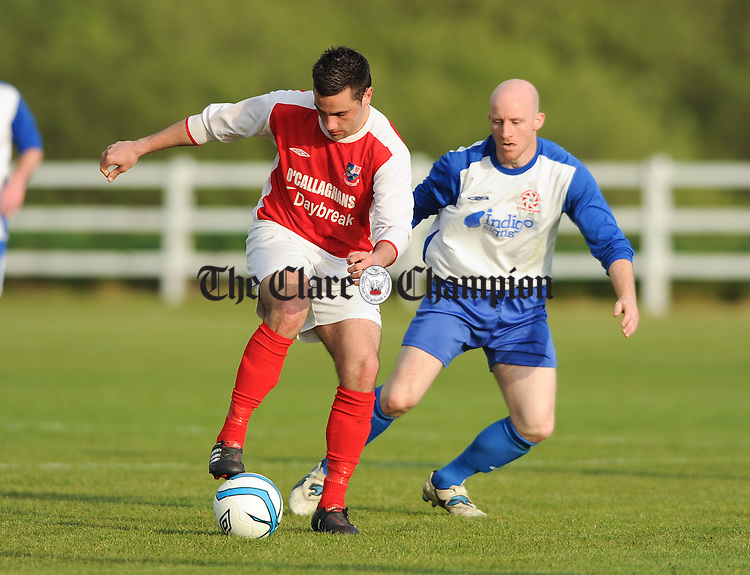 Dean Ryan of Corofin Harps in action against Alan Brigdale of Newmarket Celtic during the Clare Cup final at Doora. Photograph by John Kelly.