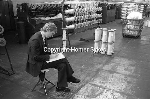 Salts Mill. Saltaire near Shipley, Bradford, West Yorkshire England 1981. MD OF SALT MILLS WORKS ON THE FACTORY FLOOR.  World Heritage Site