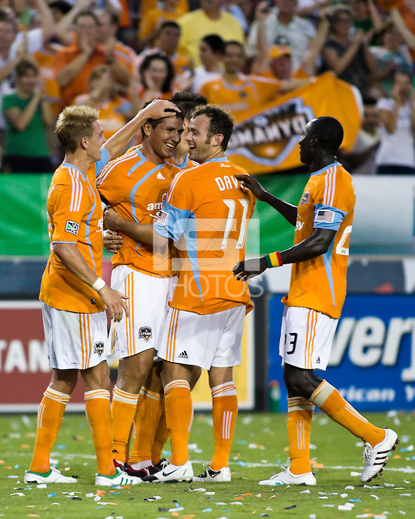 Houston Dynamo midfielder Stuart Holden (22), Houston Dynamo forward Brian Ching (25), Houston Dynamo midfielder Brad Davis (11), and Houston Dynamo forward Dominic Oduro (23) celebrate a goal.  Houston Dynamo defeated D.C. United 4-3 at Robertson Stadium in Houston, TX on August 1, 2009.