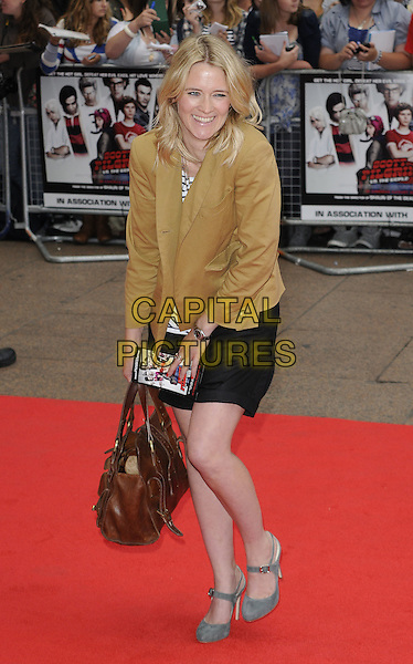 EDITH BOWMAN .at the UK premiere of 'Scott Pilgrim Vs. The World' held at the Empire cinema, Leicester Square, London, England, 18th August 2010..Arrivals full  length blue and white striped top breton beige mustard yellow jacket black shorts bag brown mary janes suede shoes green smiling .CAP/CAN.©Can Nguyen/Capital Pictures.