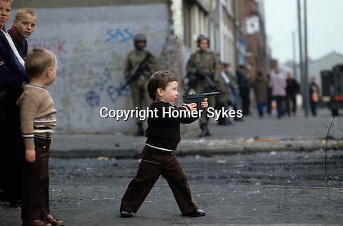 Child playing with guns, during The Troubles Belfast 1981 Northern Ireland  1980s