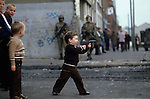 Child playing with guns, during The Troubles Belfast 1981 Northern Ireland  1980s<br />