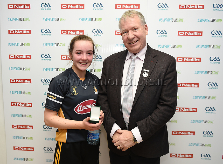 19/03/2018; 40x20 All Ireland Juvenile Championships Finals 2018; Kingscourt, Co Cavan;<br /> Girls Under-14 Singles; Kilkenny (Amy Brennan) v Tyrone (Clodagh Munroe)<br /> Amy Brennan is presented with her runners-up medal by GAA Handball President Joe Masterson<br /> Photo Credit: actionshots.ie/Tommy Grealy