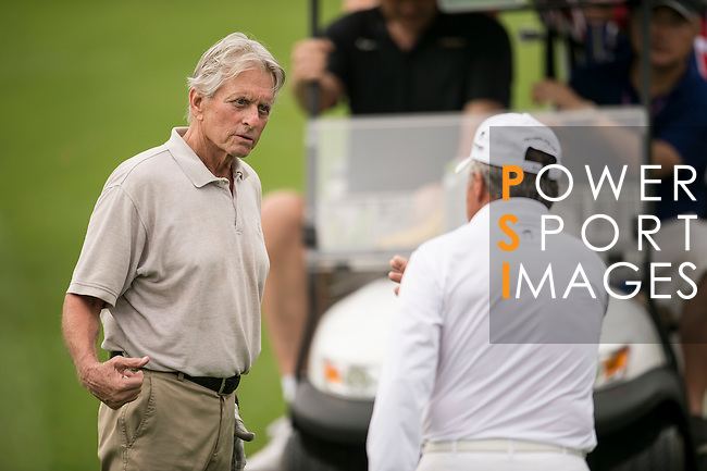 Michael Douglas (left) and Gary Player (right) during the World Celebrity Pro-Am 2016 Mission Hills China Golf Tournament on 23 October 2016, in Haikou, Hainan province, China. Photo by Marcio Machado / Power Sport Images