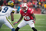 Wisconsin Badgers defensive back Dontye Carriere-Williams (29) defends during an NCAA College Big Ten Conference football game against the Michigan Wolverines Saturday, November 18, 2017, in Madison, Wis. The Badgers won 24-10. (Photo by David Stluka)