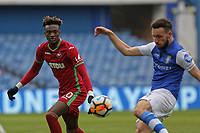 (L-R) Tammy Abraham of Swansea City looks on as Morgan Fox of Sheffield Wednesday kicks the ball away during The Emirates FA Cup Fifth Round match between Sheffield Wednesday and Swansea City at Hillsborough, Sheffield, England, UK. Saturday 17 February 2018