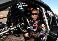 Feb. 17 2012; Chandler, AZ, USA; NHRA pro stock driver Erica Enders strapping in to make a pass at the Arizona Nationals at Firebird International Raceway. Mandatory Credit: Mark J. Rebilas-