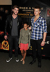 LOS ANGELES, CA - MARCH 22: Liam Hemsworth, Amandla Stenberg and Alexander Ludwig of Lionsgate's 'The Hunger Games' pose at Barnes & Noble at The Grove on March 22, 2012 in Los Angeles, California.