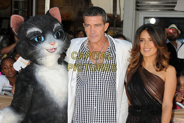 Antonio Banderas and Salma Hayek.The L.A. Premiere of 'Puss in Boots' held at The Regency Village Theatre in Westwood, California, USA..October 23rd, 2011.half length dress black brown sheer one shoulder costume white suit jacket check shirt .CAP/ADM/BP.©Byron Purvis/AdMedia/Capital Pictures.