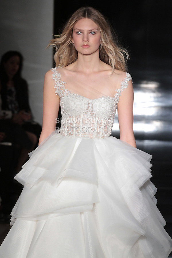 Model walks runway in an organza ball gown with layered skirt and embroidered corset bodice, from the Reem Acra Spring 2017 bridal collection, during New York Bridal Fashion Week Spring Summer 2017, on April 15, 2016.