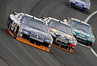 Feb 22, 2009; Fontana, CA, USA; NASCAR Sprint Cup Series driver Reed Sorenson (left) races alongside Aric Almirola (center) and Dale Earnhardt Jr during the Auto Club 500 at Auto Club Speedway. Mandatory Credit: Mark J. Rebilas-