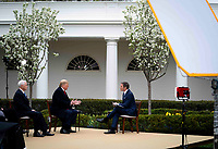 United States President Donald J. Trump and US Vice President Mike Pence participate in a Fox News Virtual Town Hall with Anchor Bill Hemmer, in the Rose Garden of the White House in Washington, DC, Tuesday, March, 24, 2020.<br /> Credit: Doug Mills / Pool via CNP/AdMedia