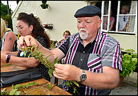 BNPS.co.uk (01202 558833)<br /> Pic: Graham Hunt/BNPS<br /> <br /> Nick Dickinson competing in the World Nettle Eating Championships at the Bottle Inn, Marshwood, Dorset, UK.
