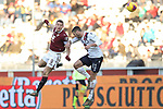 Andrea Belotti of Torino FC heads goalwards under pressure form Mattia Bani of Bologna during the Serie A match at Stadio Grande Torino, Turin. Picture date: 12th January 2020. Picture credit should read: Jonathan Moscrop/Sportimage