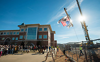 NWA Democrat-Gazette/BEN GOFF @NWABENGOFF<br /> Guests watch as a crane hoists the ceremonial final beam Wednesday, Jan. 9, 2019, during a topping-out ceremony for the new Integrated Design Lab at Northwest Arkansas Community College in Bentonville. Construction began on the new facility in July. It will be home to the college's workforce construction management and visual arts programs when completed.