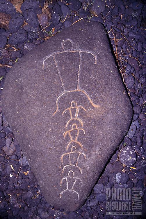 Petroglyph detail of a men, Waikoloa Beach Resort.