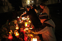 Krakovians light vigil candles in the Krakow city center in honor of Polish President Lech Kaczynski. He and many of the country's top leaders were killed in a plane crash Saturday morning on route to the site of a Soviet massacre of Polish officers during World War II. . April 10, 2010