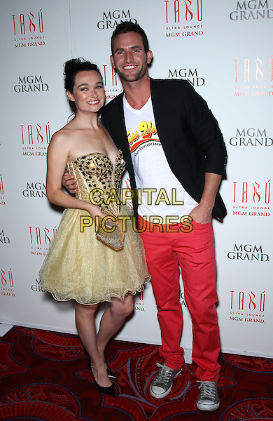 "Kristen Ruhlin, Tyler Barnes.Cast of ""She Wants Me"" celebrates movie release at Tabu Ultra Lounge inside MGM Grand Las Vegas, Las Vegas, Nevada, USA, .20th April 2012..full length red trousers white t-shirt black jacket gold yellow bustier prom dress   trainers .CAP/ADM/MJT.© MJT/AdMedia/Capital Pictures."