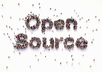 """Overhead view of people forming words """"open source"""""""