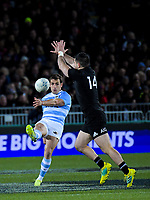Nicolas Sanchez clears under pressure from Nehe Milner-Skudder during the Rugby Championship match between the New Zealand All Blacks and Argentina Pumas at Trafalgar Park in Nelson, New Zealand on Saturday, 8 September 2018. Photo: Dave Lintott / lintottphoto.co.nz