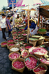 Temple Flower Offerings, Bali, Indonesia, Asia, photo bali217, Photo Copyright:  Lee Foster, www.fostertravel.com, 510-549-2202, lee@fostertravel.com,  market, shoppers, baskets, flora, flowers, pebbles, fruit, vegtables, business, vertical