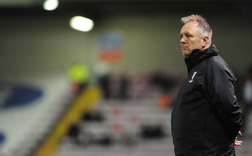 Lincoln City manager Gary Simpson <br /> <br /> Photo by Chris Vaughan/CameraSport<br /> <br /> Football - FA Challenge Cup Fourth Qualifying Round replay - Lincoln City v Alfreton Town - Tuesday 28th October 2014 - Sincil Bank - Lincoln<br /> <br /> &copy; CameraSport - 43 Linden Ave. Countesthorpe. Leicester. England. LE8 5PG - Tel: +44 (0) 116 277 4147 - admin@camerasport.com - www.camerasport.com