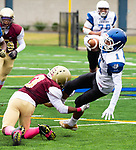 WATERBURY,  CT-101219JS19- Crosby's Jose Soares (1) gets brought down by Mark Williams (3) Sacred Heart-Kaynor's (3) during their game Saturday at Municipal Stadium in Waterbury.<br /> Jim Shannon Republican-American