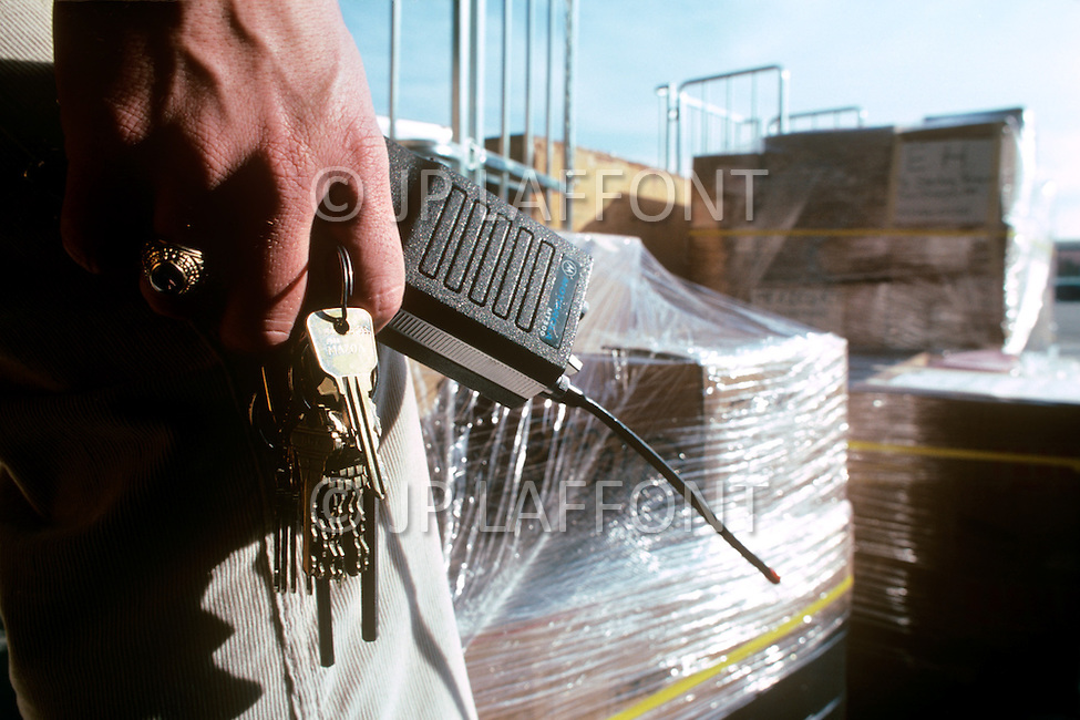 Silicon Valley, California - February 1983. A key ring and a walkie-talkie are apart of the equipment of the security officers at the ROLM factory. Silicon Valley is the largest high-tech manufacturing center in the United States, and is the region most famous for innovations in software and Internet services.