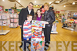 Manager of Manor West Retail Centre Derek Rusk and manager of Mothercare presented Liz O'Brien and her son Derek O'Shea with gifts after being so moved at the recent acts of bravery by Liz and good Samaritan Fabien Lugandu who both jumped into a river to save Liz's 10 year son.