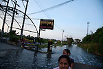 Women ride home from work in the back of a truck near Ram Inthra Road, northern Bangkok.<br /> <br /> Thailand's worst floods for 50 years finally reached the suburbs of Bangkok in October 2011. While the government dithered and argued with itself, more than 200 people died.