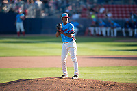 Spokane Indians relief pitcher Emmanuel Clase (23) gets ready to deliver a pitch during a Northwest League game against the Vancouver Canadians at Avista Stadium on September 2, 2018 in Spokane, Washington. The Spokane Indians defeated the Vancouver Canadians by a score of 3-1. (Zachary Lucy/Four Seam Images)