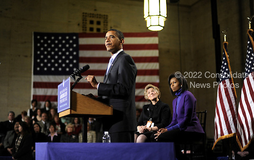 Philadelphia, PA - January 17, 2009 -- United States President-elect Barack Obama delivers remarks during a rally to kickoff his Whistle Stop Train Tour in Philadelphia on Saturday, January 17, 2009. The ceremonial trip will carry President-elect Obama, Vice President-elect Biden and their families to Washington for their inaugurations with additional events in Philadelphia, Wilmington and Baltimore. Obama, who will be sworn in as the 44th President of the United States on January 20, 2009, was joined on stage by his wife Michelle (R) and Patricia Stiles a resident of Parker, Colorado..Credit: Kevin Dietsch - Pool via CNP