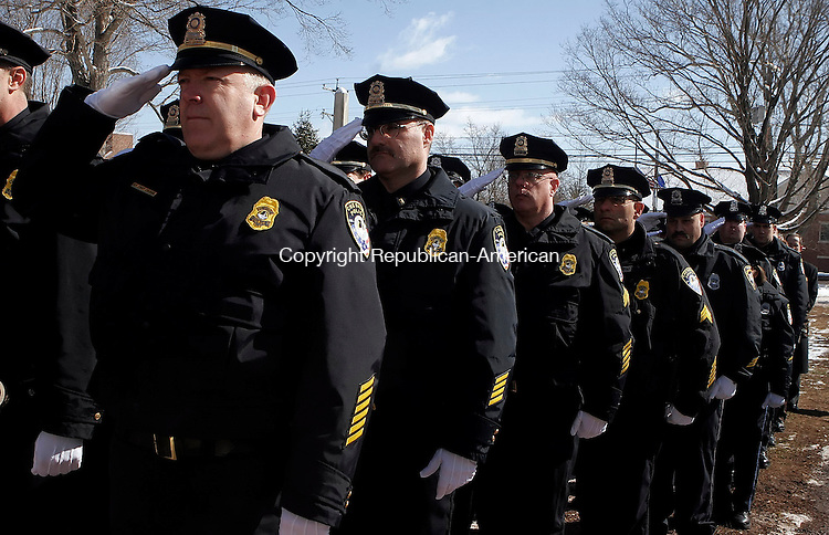 CHESHIRE, CT03 March 2006-030306TK07 The  Cheshire Police snap a salute as the casket of Cheshire Chief of Police is carried into church.  Tom Kabelka / Republican-American