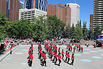 Calgary Olympic Sguare in downtown  Calgary, Alberta, Canada.  colourful. colorful, bright, action, dancing, activity, poeple, onlookers, audience, excitement, crowd, Choreography,