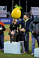The Efird family celebrates after winning a $2,500 trip to Hawaii following the South Atlantic League game between the Asheville Tourists and the Kannapolis Intimidators at Kannapolis Intimidators Stadium on May 6, 2017 in Kannapolis, North Carolina.  The Intimidators walked-off the Tourists 7-6.  (Brian Westerholt/Four Seam Images)
