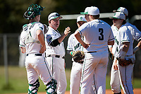 Dartmouth Big Green head coach Bob Whalen (2) talks with relief pitcher Michael Parsons (center), catcher Kyle Holbrook (9), third baseman Justin Fowler (25), shortstop Nate Ostmo (5), second baseman Sean Sullivan (4), and first baseman Michael Calamari (3) during a game against the Villanova Wildcats on March 3, 2018 at North Charlotte Regional Park in Port Charlotte, Florida.  Dartmouth defeated Villanova 12-7.  (Mike Janes/Four Seam Images)