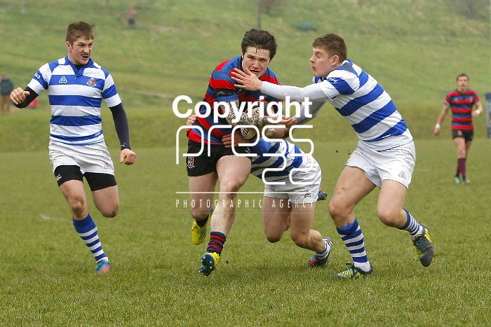 05/03/2013 Edward O'Keeffe of St Munchins College is tracked by Willie Coffey,  David O'Mahony and Aidan Moynihan of Rockwell College in the Munster Schools Senior Cup Semi Final which took place at Clanwilliam Park, Tipperary Picture: Don Moloney / Press 22