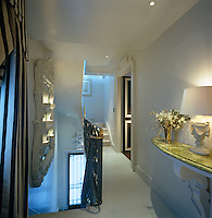 The landing is furnished with a marble-topped console table