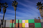 Palm trees and colorful brick wall along Santa Monica beach
