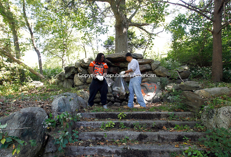 Waterbury, CT- 14 September 2014-091414CM02-  Ernest Jones, a running back with the Brass City Brawlers football team, left, and Gerry Reyes of Waterbury, clean up around the grotto inside Fulton Park on Sunday.  The pair were among volunteers who were cleaning up the park, an effort organized by the Historic Overlook Community Club.   Christopher Massa Republican-American