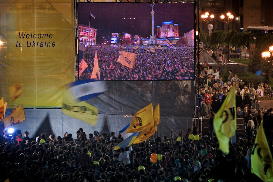 Kiev, Ukraine, 21/05/2005..The fiftieth Eurovision Song Contest..The crowd of some 300,000 packed into Maidan Square is reflected on a giant television monitor prepared for a live broadcast of the final.