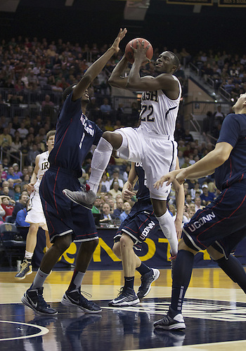 January 12, 2013:  Notre Dame guard Jerian Grant (22) goes up for a shot as Connecticut forward DeAndre Daniels (2) defends during NCAA Basketball game action between the Notre Dame Fighting Irish and the Connecticut Huskies at Purcell Pavilion at the Joyce Center in South Bend, Indiana.  Connecticut defeated Notre Dame 65-58.