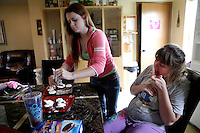 """Kara and Kayla make Whoopie Pies together after Kara gets home from school. Kayla has limited physical mobility and uses a walker. """"I'm still used to her being able to do everything I'm able to do,"""" Kara said."""
