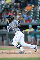 Center fielder Gerson Molina (12) of the Columbia Fireflies, playing as the Chicharrones de Columbia, bats in a game against the Charleston RiverDogs on Friday, July 12, 2019 at Segra Park in Columbia, South Carolina. The RiverDogs won, 4-3, in 10 innings. (Tom Priddy/Four Seam Images)