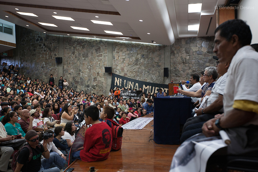 Felipe de la Cruz Sandoval (C), the spokesman for the parents and parents of the 43 missing students from Ayotzinapa's teacher training college address medias and students to inform about the situation in Guerrero State during a conference at the University Center for Social Sciences and Humanities in Guadalajara, Jalisco, Mexico on November 18, 2014. The parents and relatives of the 43 missing students still do not believe the official line that the young men are all dead, and with classmates, social organizations and human rights defenders, they started on Thursday a national caravan. They split up into three different caravans, branching out to share information face to face with supporters in other cities and rally nationwide support. The three groups will meet in Mexico City on Thursday 20 for a general strike and massive marches to demand justice and fight against corrupted government and organized crime. Criticism of the government has intensified in Mexico, and many are demanding that the search for the 43 missing students continue until there is concrete evidence to the contrary. (Photo by Bénédicte Desrus)