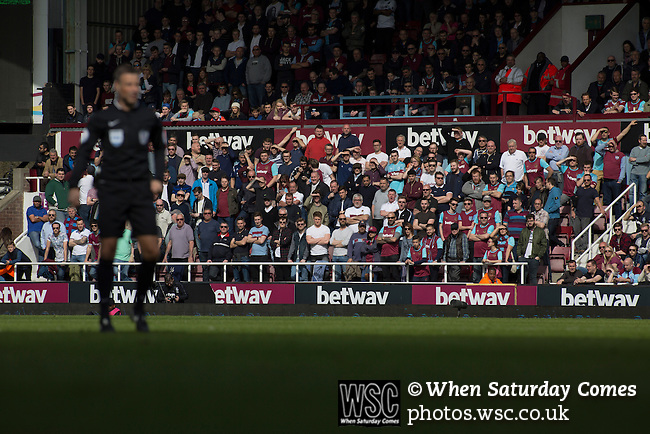West Ham United 2 Crystal Palace 2, 02/04/2016. Boleyn Ground, Premier League. Home fans in the Chicken Run section of the East Stand watching the first-half action at the Boleyn Ground as West Ham United hosted Crystal Palace in a Barclays Premier League match. The Boleyn Ground at Upton Park was the club's home ground from 1904 until the end of the 2015-16 season when they moved into the Olympic Stadium, built for the 2012 London games, at nearby Stratford. The match ended in a 2-2 draw, watched by a near-capacity crowd of 34,857. Photo by Colin McPherson.