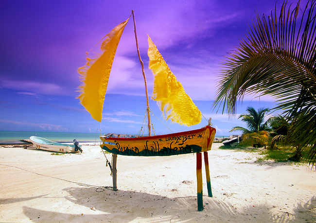 Sailboat replica advertises a local bar on the beach on Isla de Holbox, Mexico.
