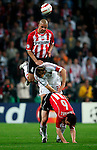 Nederland, Eindhoven ,04-05-2005.  Braziliaanse vedediger Alex van PSV speelt 'haasje over' met Ambrosini van AC Milan en Mark van Bommel van PSV.  foto Michael Kooren.