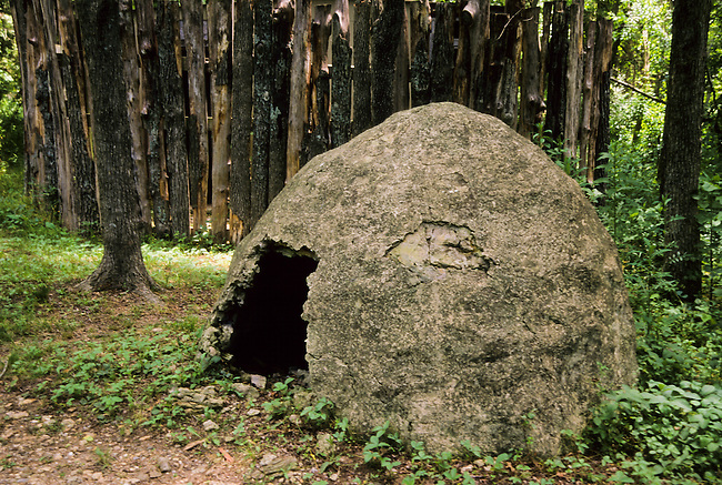 Small dome-shaped traditionally reconstructed Cherokee shelter of wattle and daub located in Tahlequah, OK.